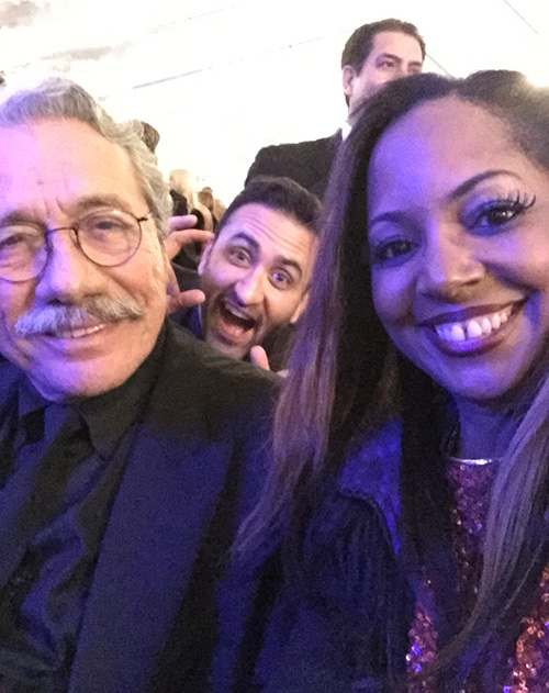 "Edward James Olmos one of the top donators of the evening to Children Uniting Nations (CUS) , stops for a selfie with ""Shooter Diva"" and gets photo bombed!"