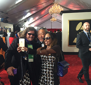 "Kitaro stops for a ""selfie"" on the red carpet at the 57th Grammy Awards Live at the Staples Center"