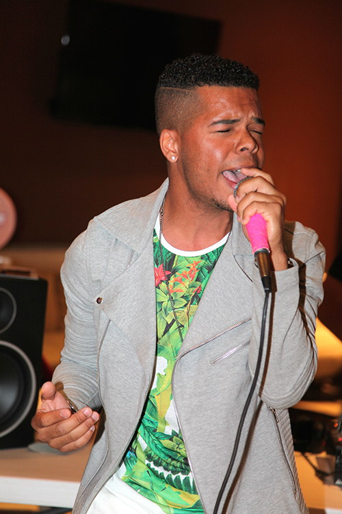 "Aaron Fresh singing newly released hit single ""Ratchet"" Opening the Trunk Fashion Show for Mister Triple X"